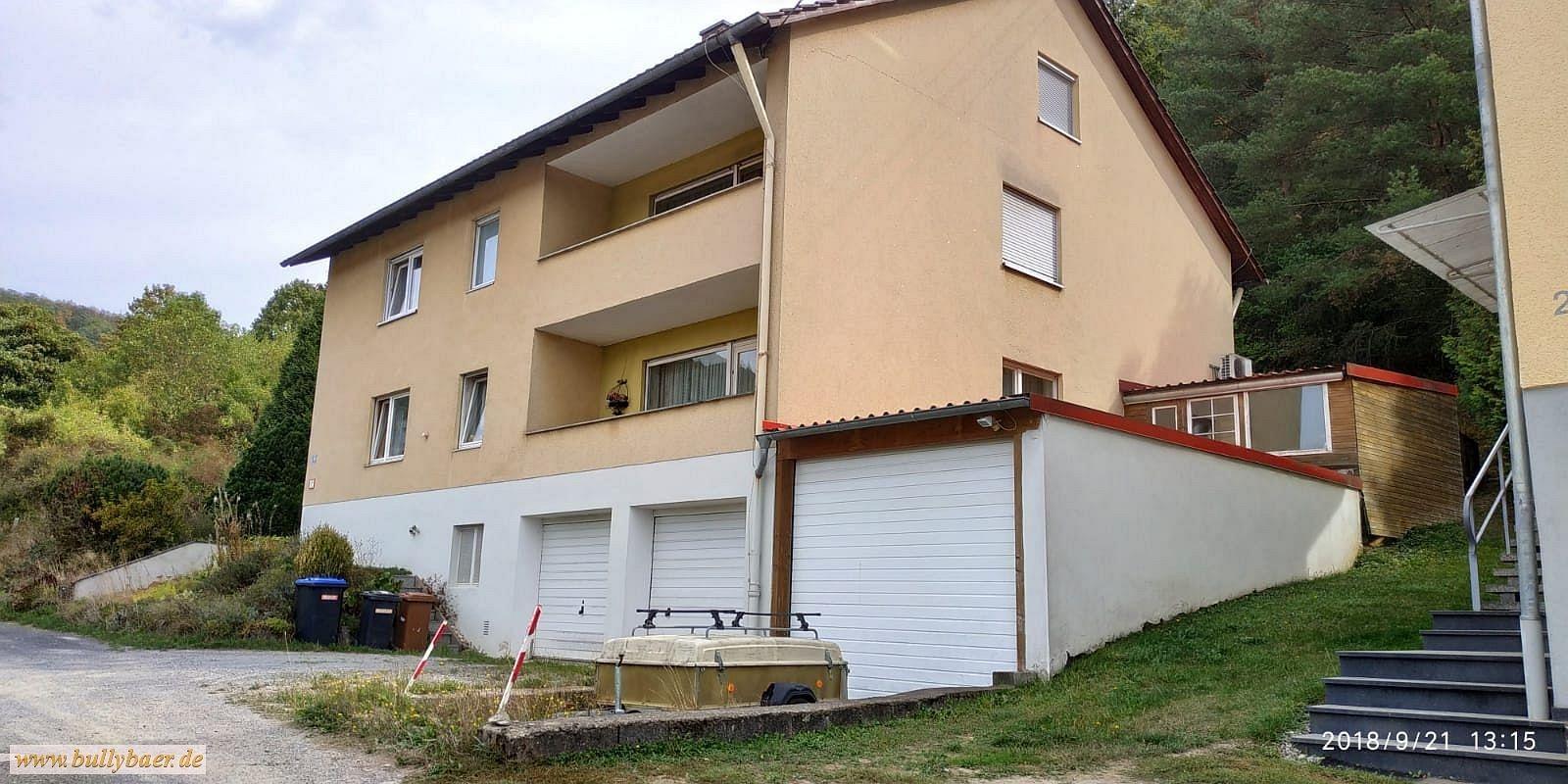 immobilie-zweifamilienwohnhaus-dachgeschoss-einliegerwohnung-zvg-haus-grundstueck-zwangsversteigerung-haeuslekaeufer